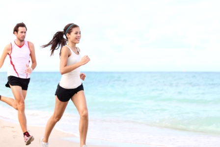bigstock-sport--couple-running-on-beac-28383395